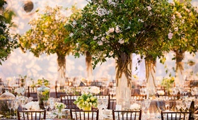 Indoor wedding reception that looks like garden