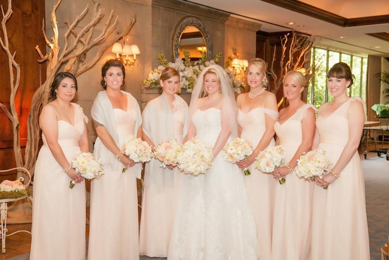Bride in Monique Lhuillier wedding dress with pink Amsale bridesmaid dresses