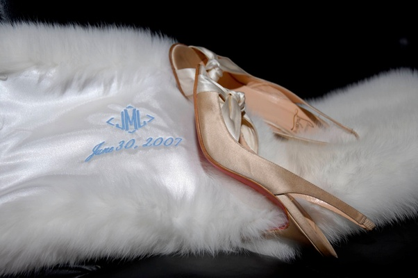 Champagne Louboutin heels and white wrap
