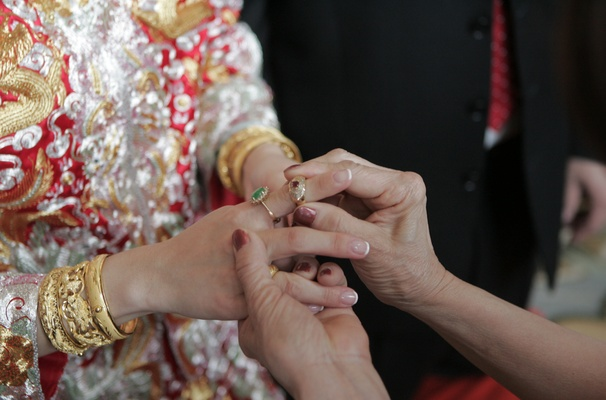 Bride receiving jewelry from family