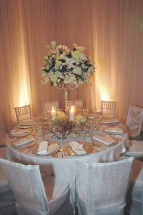 Round tables with white flower candelabra