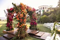 wedding ceremony wood aisle outdoor chuppah with colorful color palette pink orange flowers