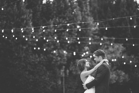 Black and white photo of bride in a strapless Anne Barge dress dances with groom at Eden Gardens, CA