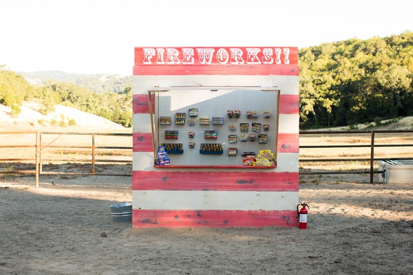 Red and white wooden firework booth at fourth of july party