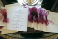 White stationery with menu selections tied with purple ribbon