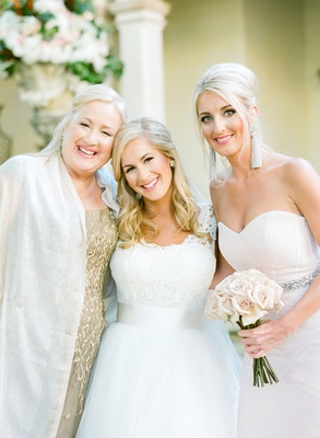 Bride in a Monique Lhuillier gown with her mother and sister