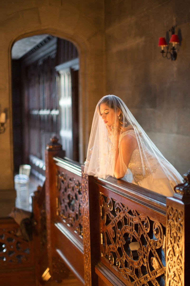 veiled bride balcony looking down berta bridal veil wedding styled shoot vintage hempstead house ny