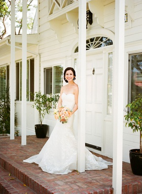 Bride at lombardi house updo strapless carolina herrera wedding dress peach bouquet flowers brick