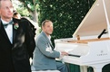 Famous pianist Jim Brickman performed ceremony music on white grand piano