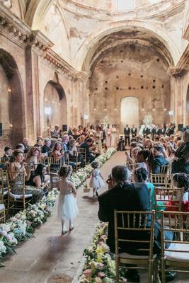 destination wedding ceremony guatemala church antigua stone aisle flower girls in flower crowns