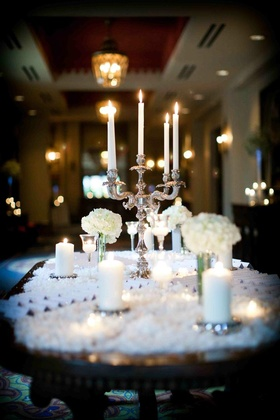 Oval table topped with snow and flowers