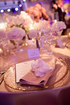 Blush dinner napkin topped with flower and pearls