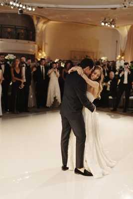 bride in strapless wedding dress naeem khan groom in loafers tuxedo first dance white dance floor