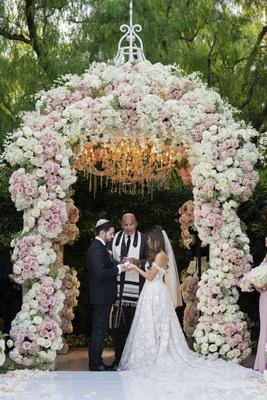 bride in off shoulder galia lahav wedding dress groom in tuxedo officiant chuppah jewish ceremony