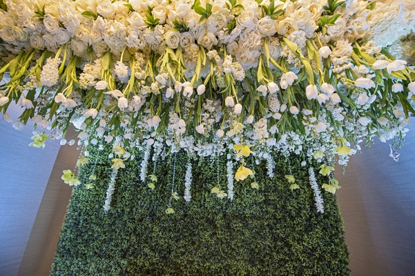 lush white roses and tulips suspended from the ceiling