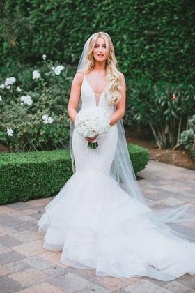 bride with long blonde hair veil white bouquet mermaid wedding dress horsehair trim lazaro