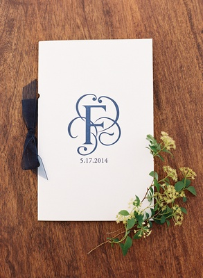 White ceremony booklet with surname initial