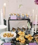 wedding event food display calzone on mini armchair, chicken sandwiches, black white stripes