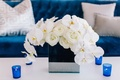 detriot lions quarterback matthew stafford rehearsal dinner decor blue couch white flowers candles