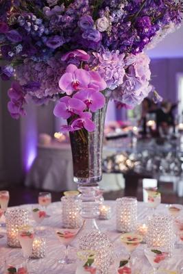 Purple orchid flower arrangement on drink table