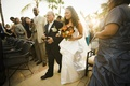 Father of bride walks bride down aisle at Florida wedding