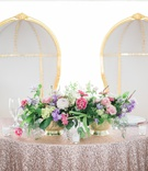 white and gold rounded thrones at sweetheart table