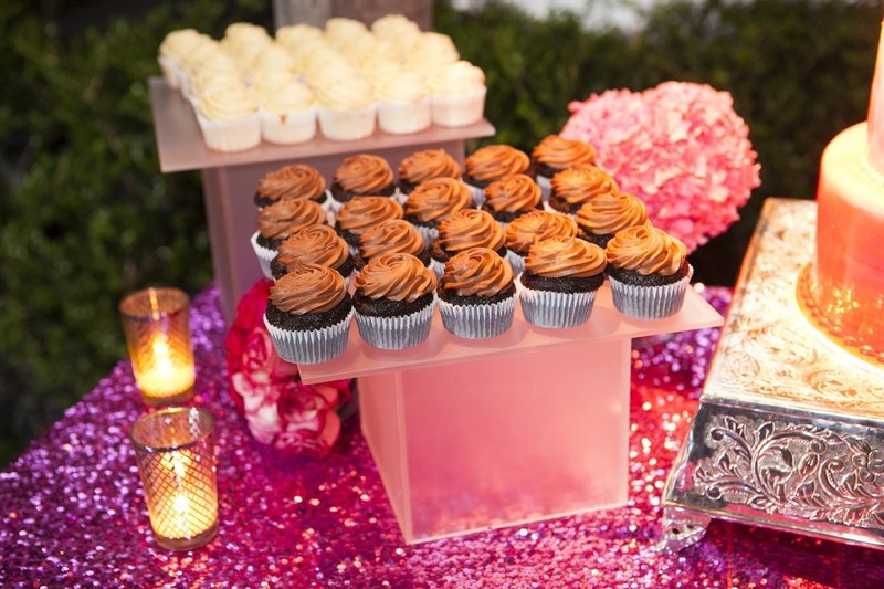 Purple sequin dessert table with vanilla and chocolate cupcakes