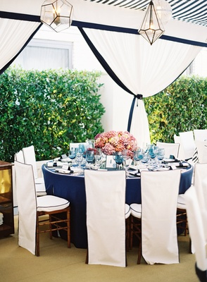 Blue-and-white tent with views of manicured hedges