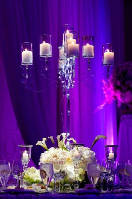 Purple lighting on clear candelabra centerpiece