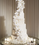 wedding cake seven layer white orchid cascading down ruffle tier