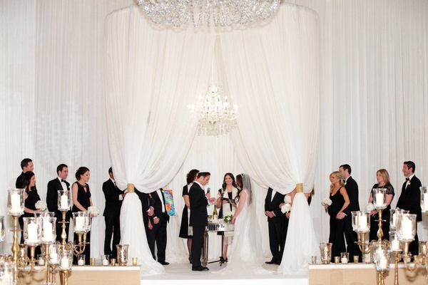Oval roof chuppah wedding ceremony Chicago white drapery candelabra black and white attire wedding