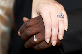 Interracial couple men's and women's wedding rings