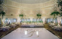 white dance floor gold monogram, crystal chandeliers with greenery