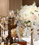 Ceremony aisle decor candelabra and tall flower arrangements white hydrangea, pink rose white rose