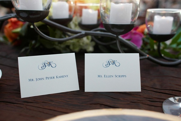 Seating card with blue lettering and rhinestone