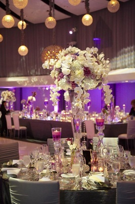 Reception centerpiece with crystal vase and floating candles