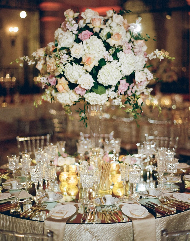 Wedding reception table mirror top crystal tall glass centerpiece rose hydrangea orchid flowers