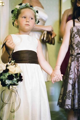 Little girl carrying kissing ball in bridal suite
