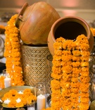 hindu wedding traditional décor with marigolds and lights spilling from pots