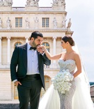 armenian couple, groom kisses bride on hand, bride in leah da gloria lace wedding dress tulle