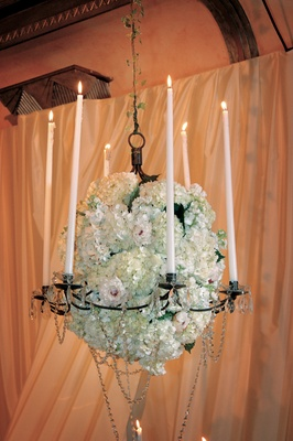 Hanging crystal chandelier centerpiece with hydrangea blooms