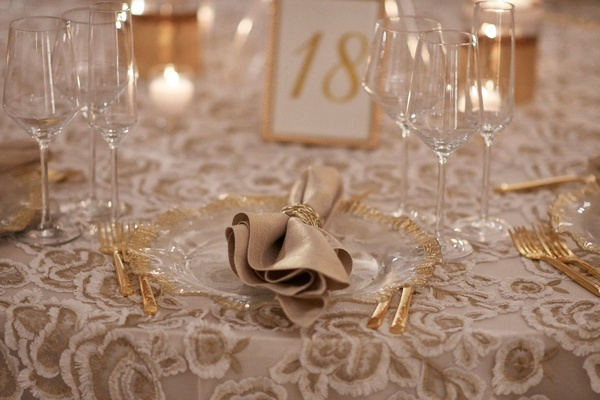 wedding reception pattern linen from nuage designs gold white flowers gold charger flatware table