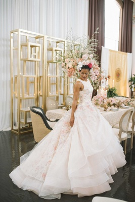 full skirt ball gown with pink floral underlay high neckline flower crown
