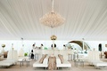 White tufted custom wedding reception bar