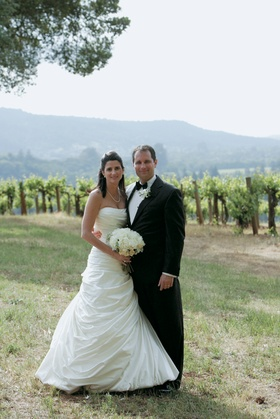 Bride in a Pnina Tornai gown and groom in a black tuxedo at Kunde Estate Vineyards