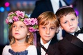 Flower girl wearing headpiece and ring bearers in yamakas