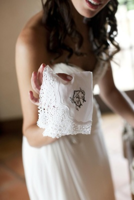 Bride holding monogrammed lace doily