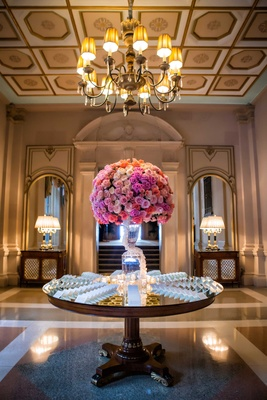 mirror round table with crystal vase topped with white, pink, violet, orange roses and garden roses