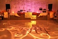 White dance floor with wedding initials and lighting