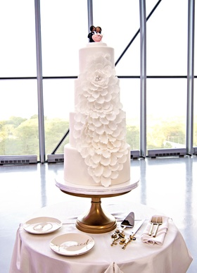 four tier wedding cake with fondant flower of cascading petals